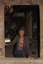 Older Akha Erpa Woman In Doorway