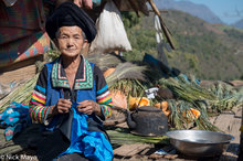 Older White Hmong Lady In Her Village