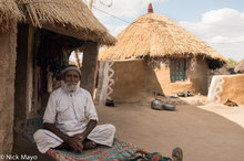 Man Outside His Thatched Bunga