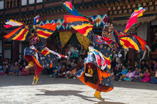 Masked Monks Performing A Cham Dance