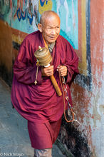 Monk With Prayer Wheel & Beads