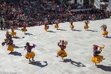 Monks Performing A Tshechu Dance
