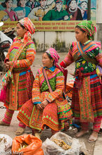 Three Flowery Hmong Women At Market