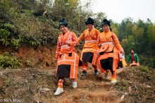 Three Women Dressed In Orange