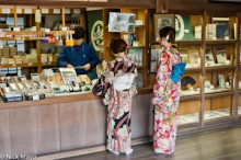 Girls In Kimonos At Temple Shop