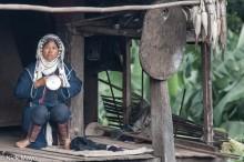 Akha Woman On Her Porch