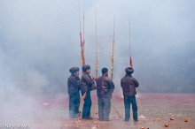 Pipers Amid Firecracker Smoke