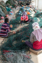 Repairing The Nets At The Harbour