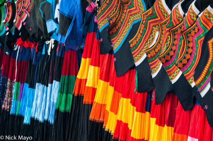 Traditional Yi skirts on sale at Niuniuba market in Daliangshan.
