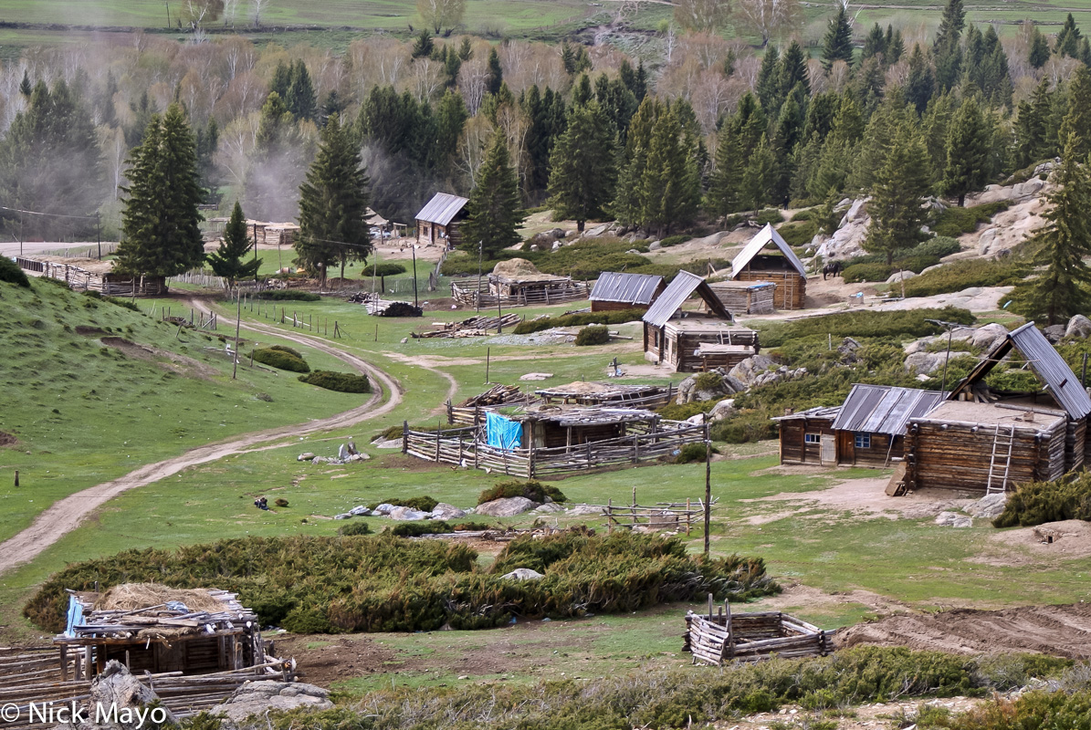 Wooden cabins and animal pens in the Tuva village of Tierekiri.
