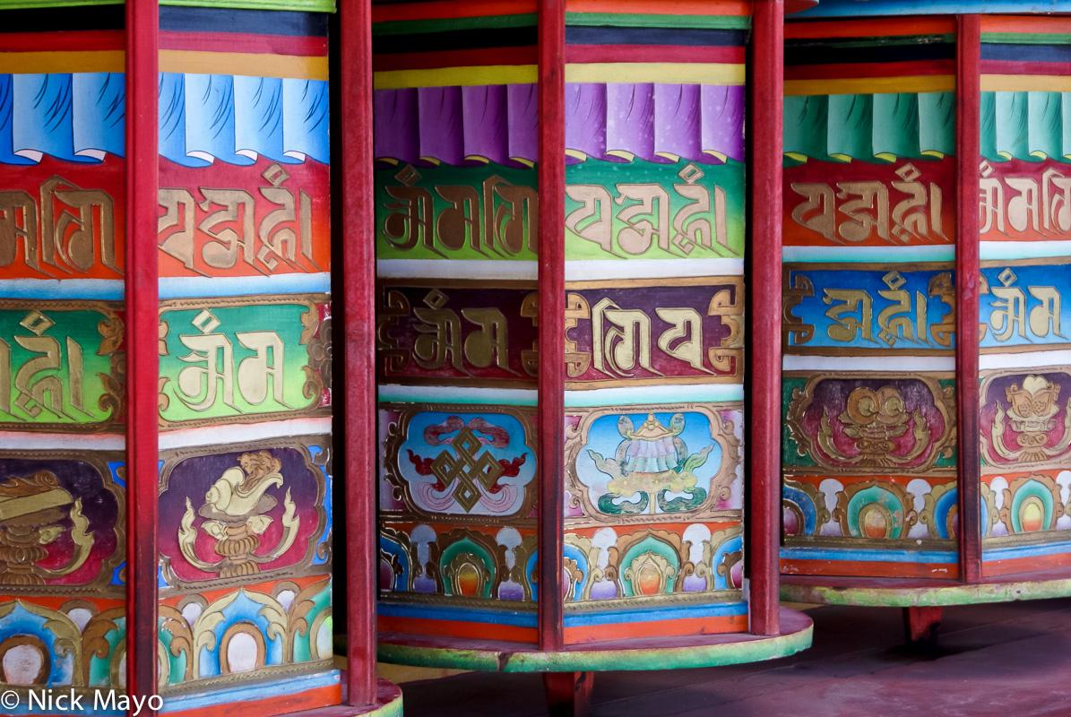Colourful prayer wheels at the Sershul monastery.
