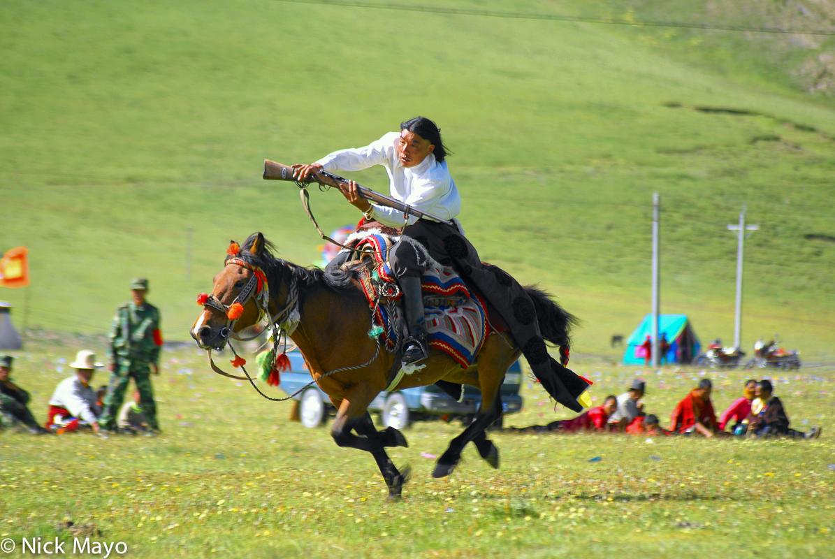 China,Festival,Horse,Rifle,Sichuan,Tibetan, photo