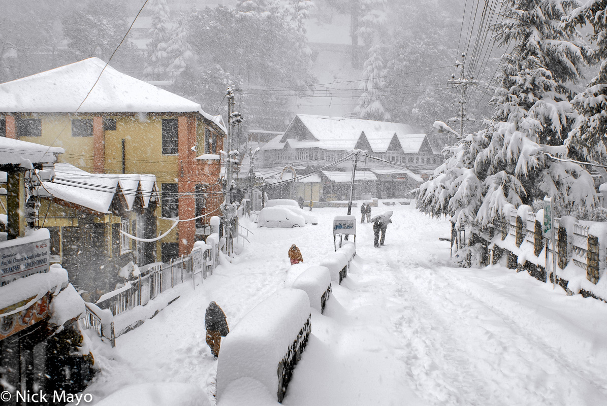 A snow covered street and shops in Dalhousie.