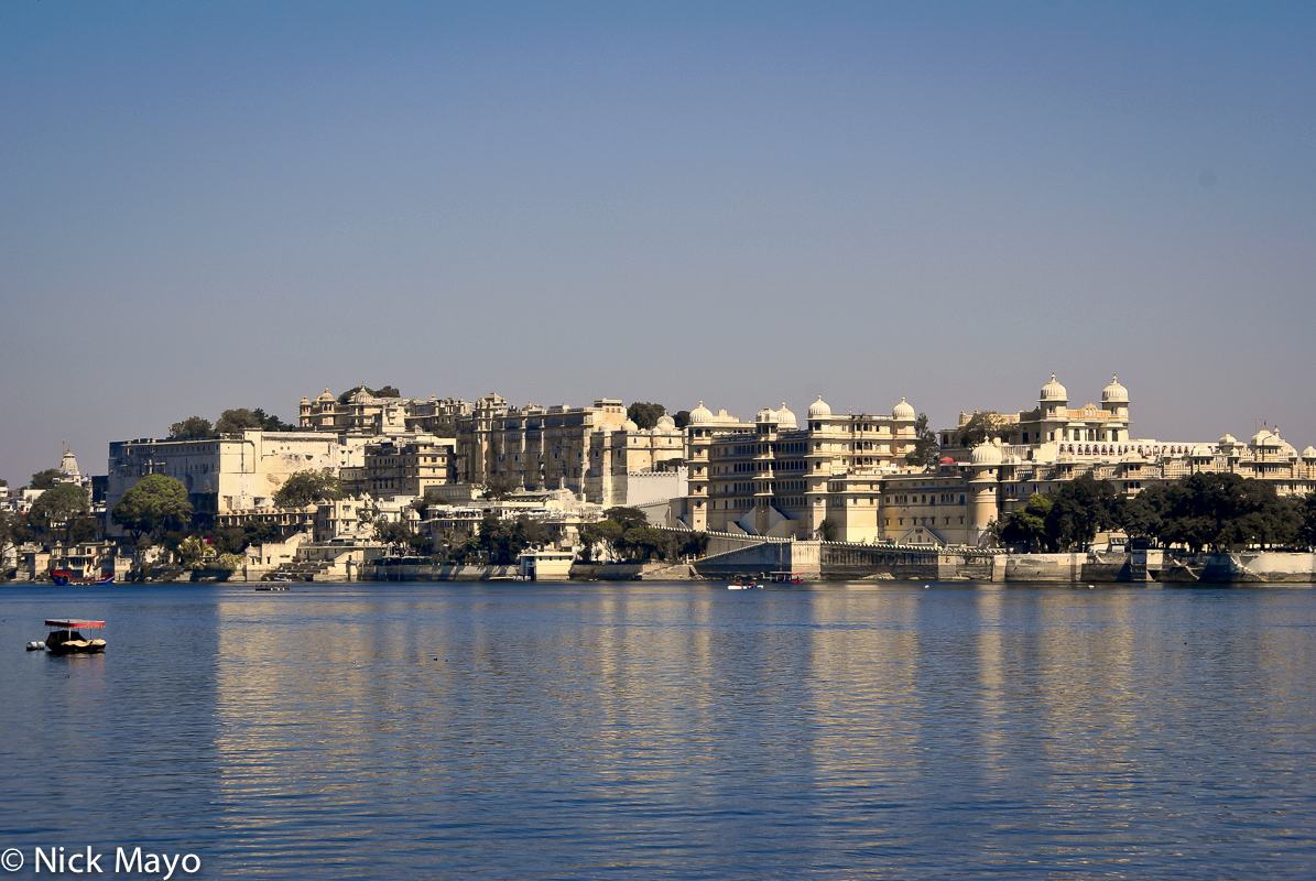 A view of the Udaipur City Palace from Pichola Lake.