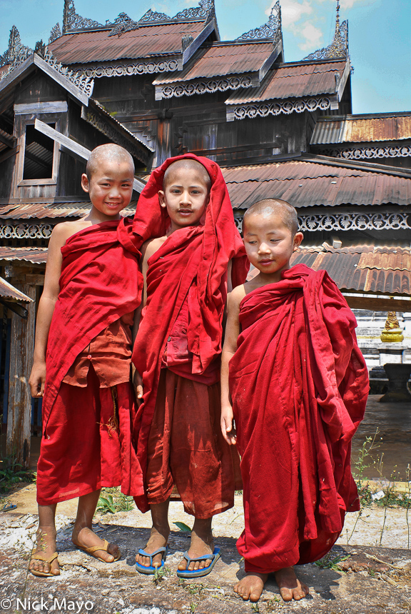 Three young monks at a monastery outside outside Kyaukme.