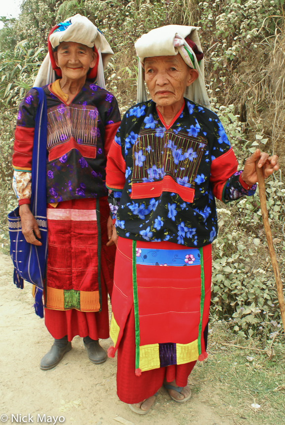 Two older Golden Palaung women in festival attire returning home to Namshan.