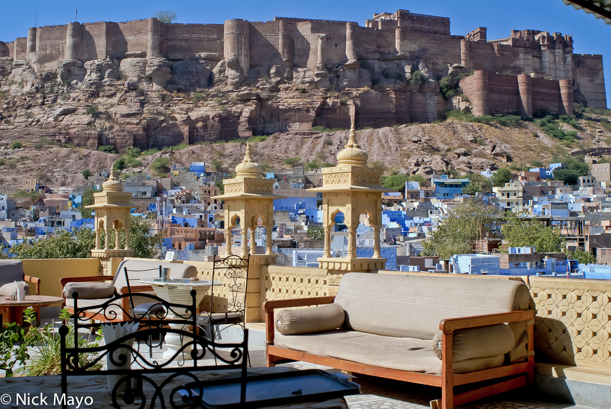 """The walls of Menrangarh Fort rising above the """"Blue City"""" of Jodhpur. The walls of Menrangarh Fort rising above the """"Blue City..."""