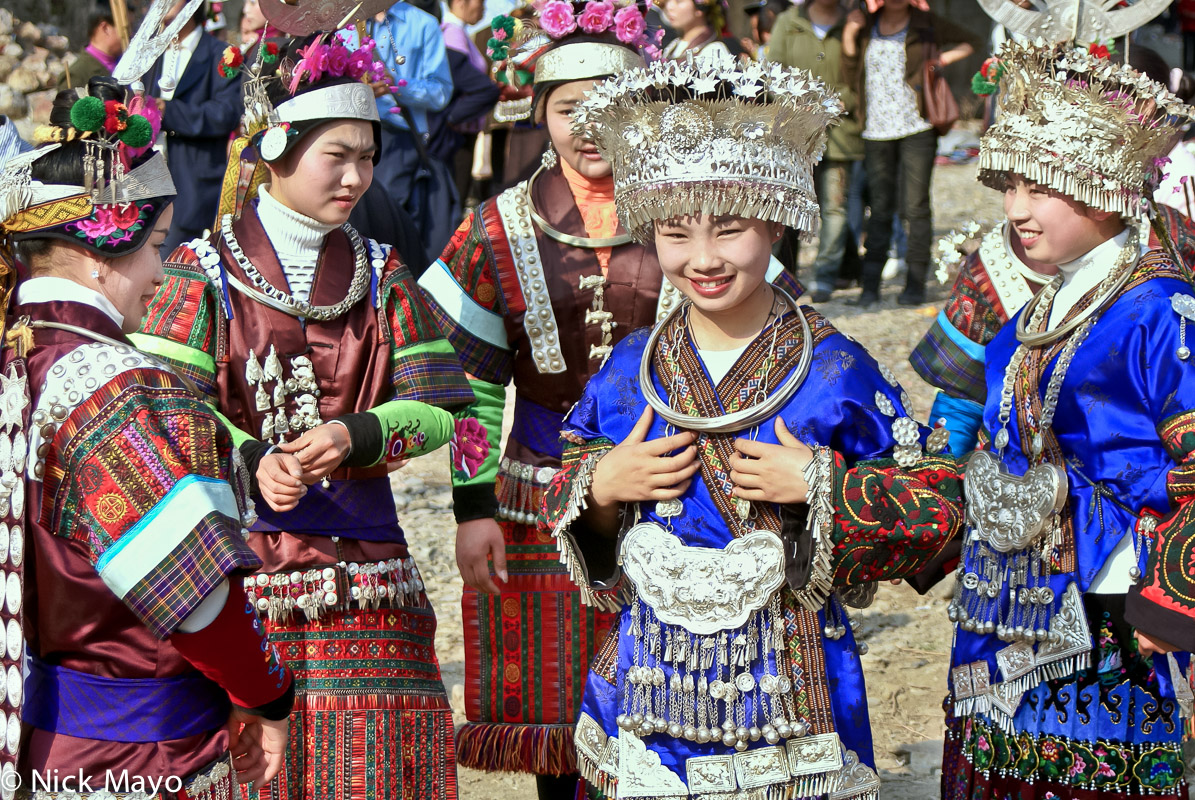 Five Miao girls at a festival in Zhouxi.