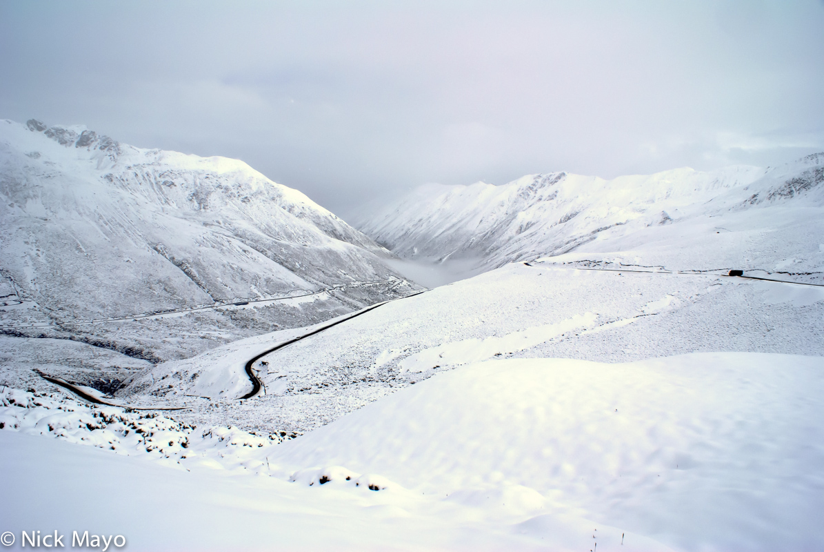 Summer snow in the valley leading to the pass on the road above Karpo.