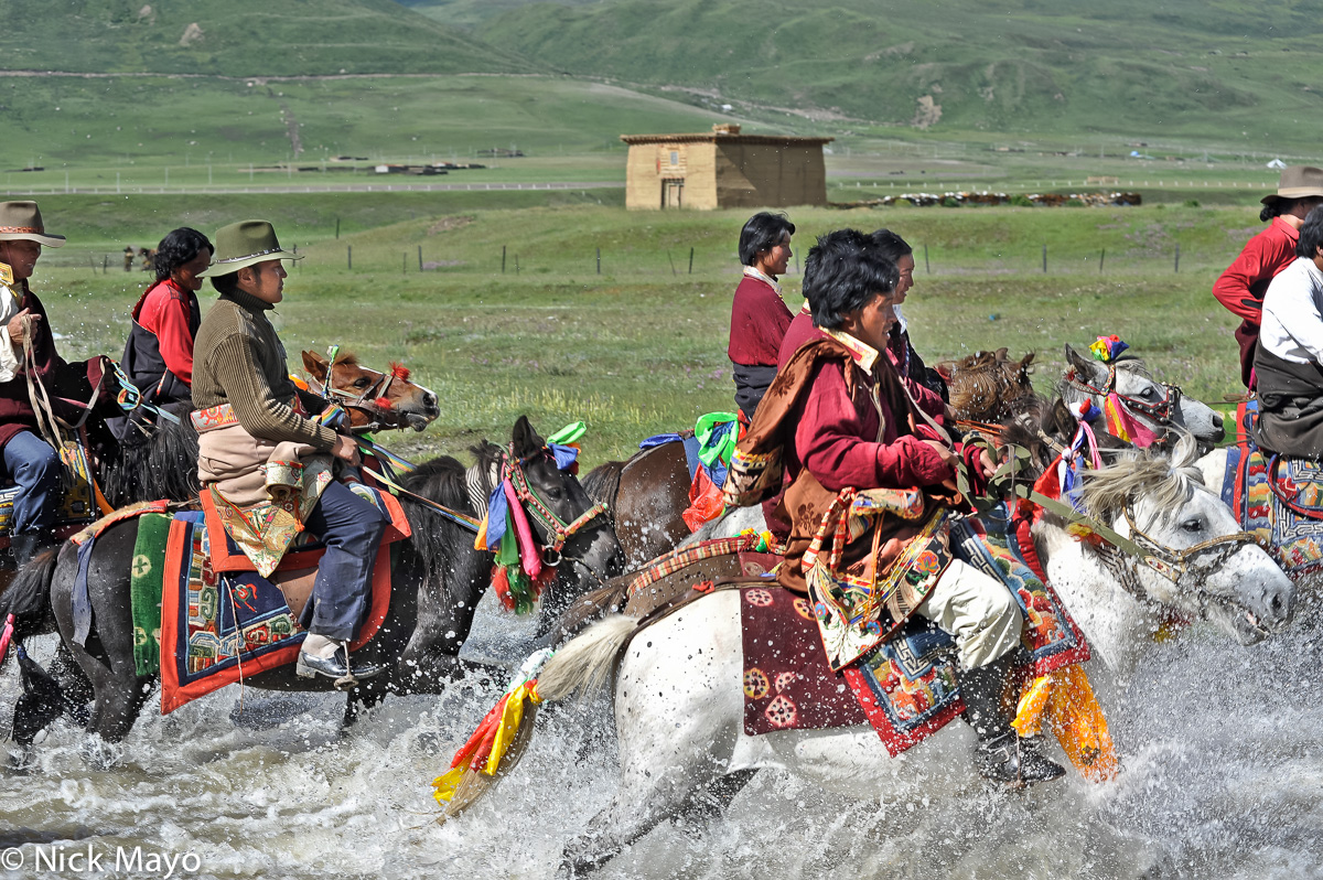 Tibetan horsemen on their way to a grassland festival near Manigango.