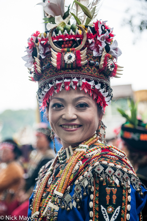 A Rukai bride, wearing a traditional hat, necklace and earrings, at a wedding in Wutai.
