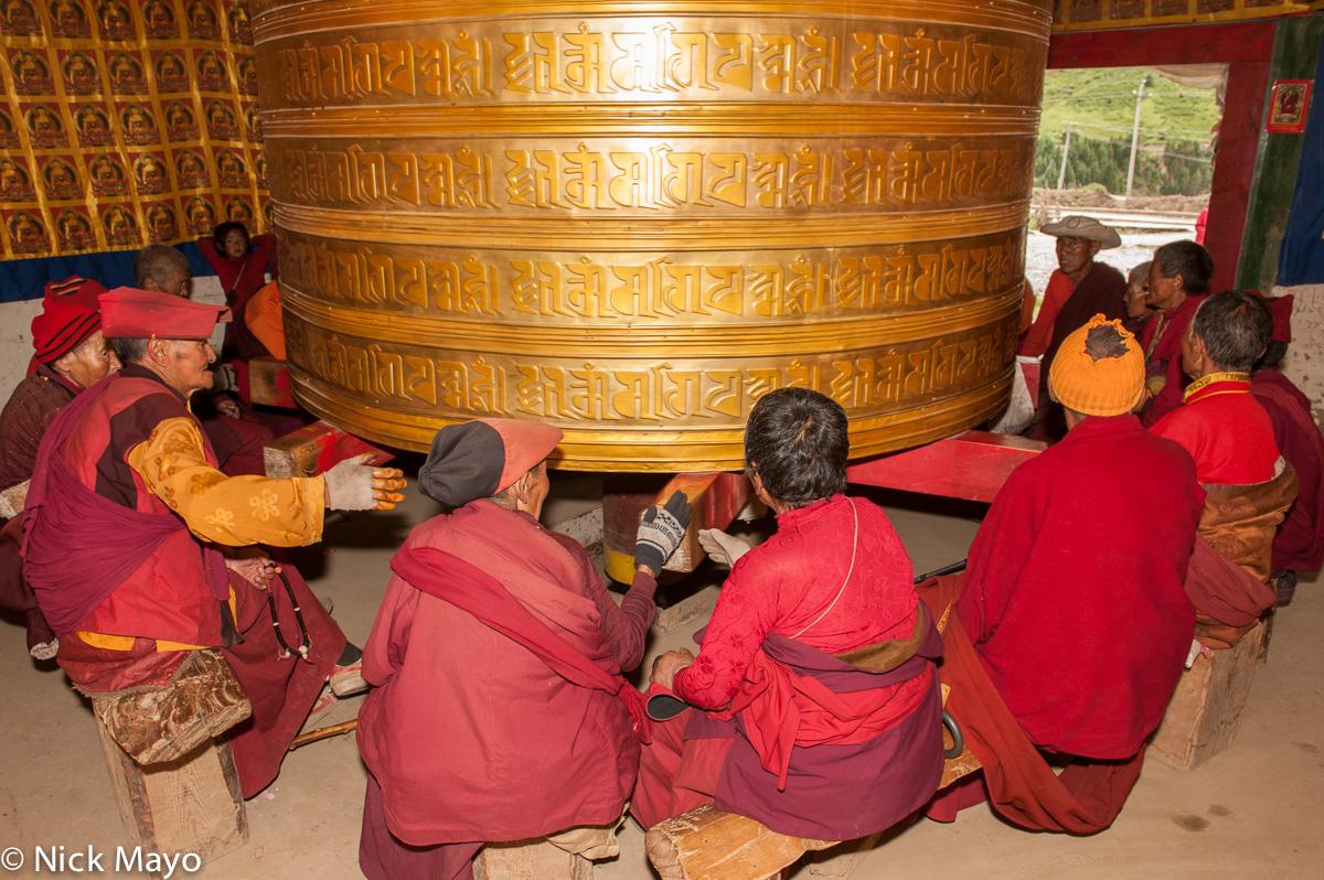 China,Hat,Monk,Nun,Prayer Wheel,Sichuan,Tibetan, photo