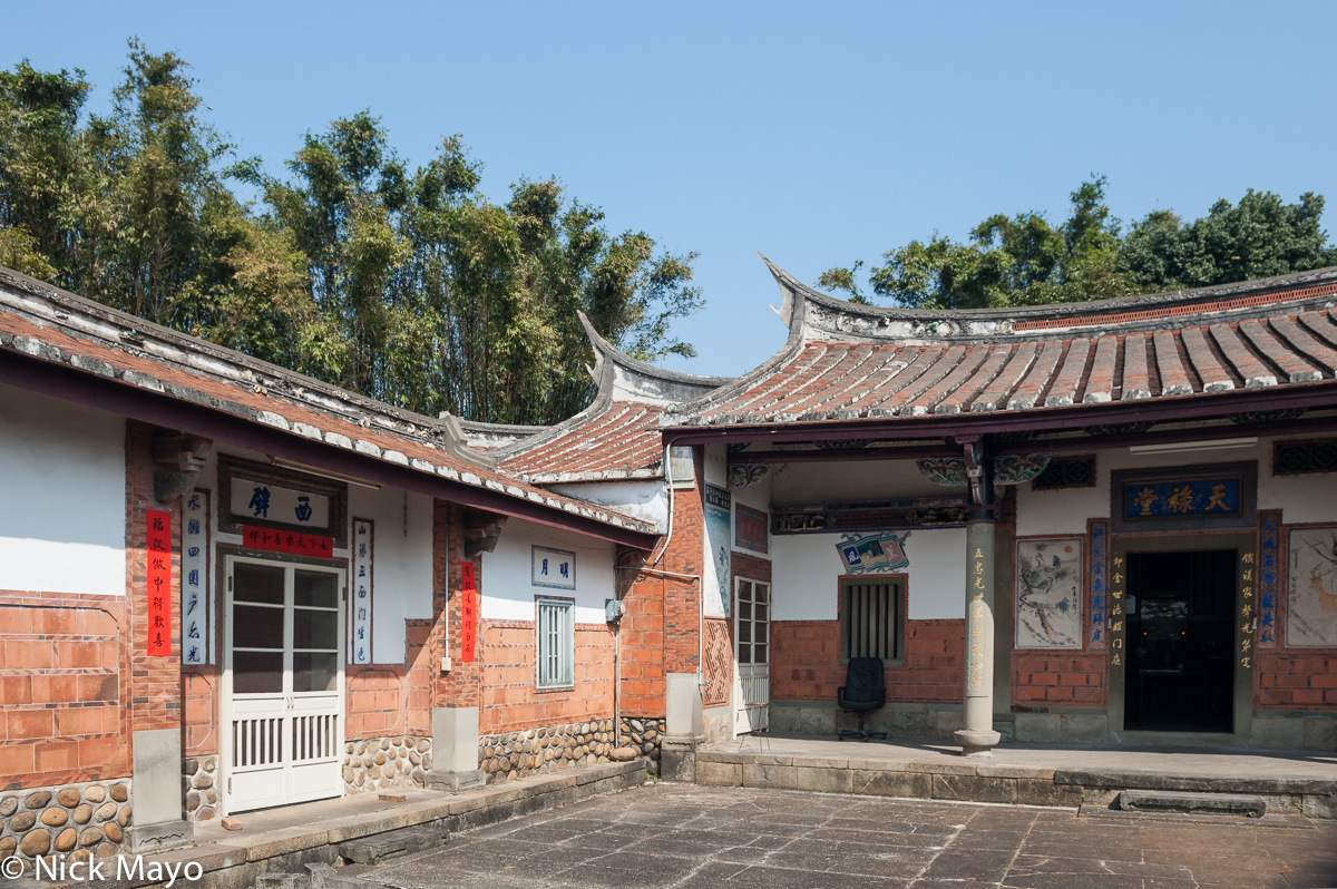 A traditional courtyard farmhouse near Xinpu with a swallow tail roof.