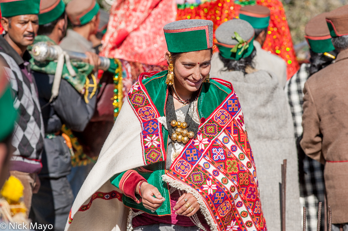 A traditionally dressed Kinnaur woman, in cape, hat, necklace, earrings and wearing gold rings, at a festival in Kalpa.