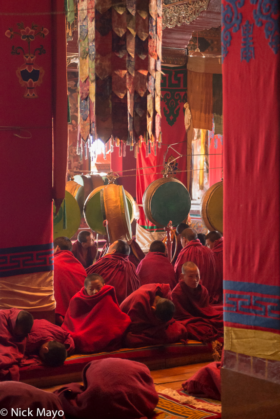 Monpa monks and novices chanting and drumming at the Torgya festival in the Tawang monastery.