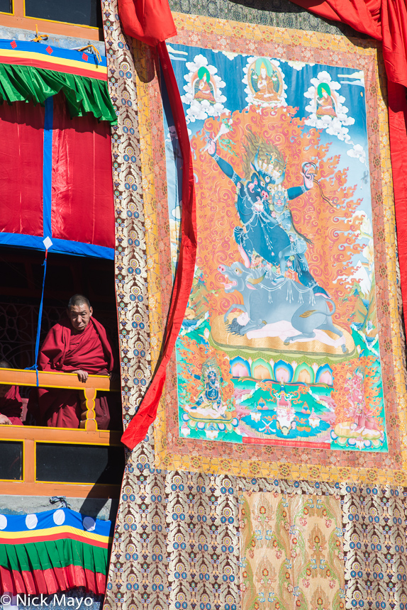 A Monpamonk with the monastery tanka at the Torgya festival in Tawang.