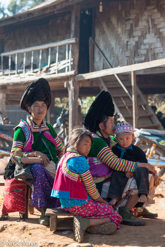 White Hmong women with their children during a festival in the village of Ban Hong.