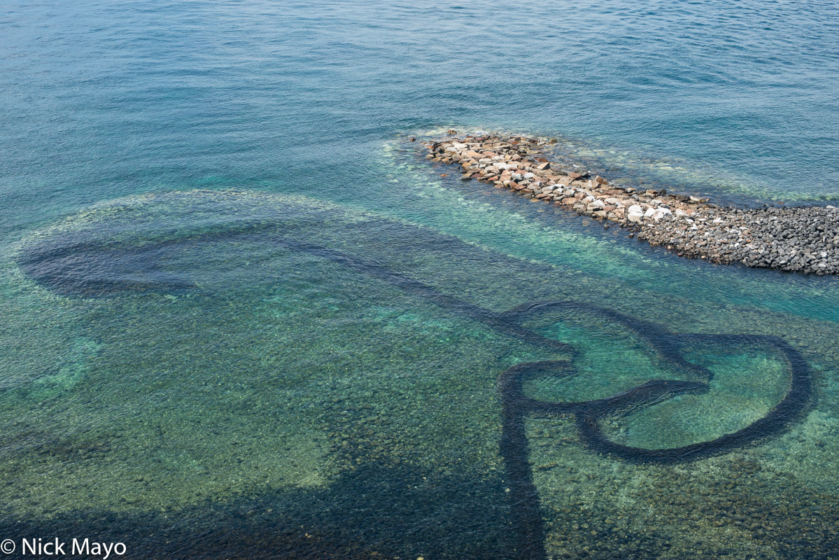 A fish trap made of coral walls in Chimei.
