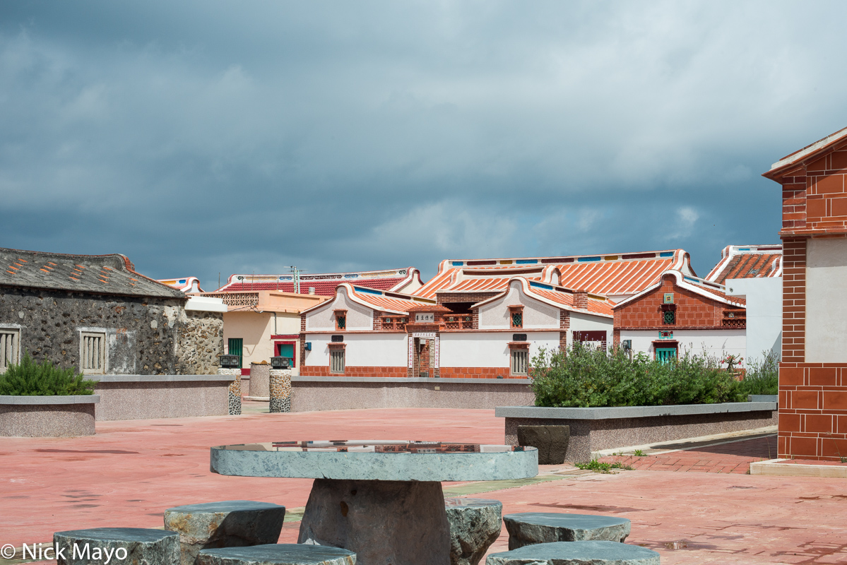 Renovated traditional houses with their distinctive roofs on the island of Chimei.