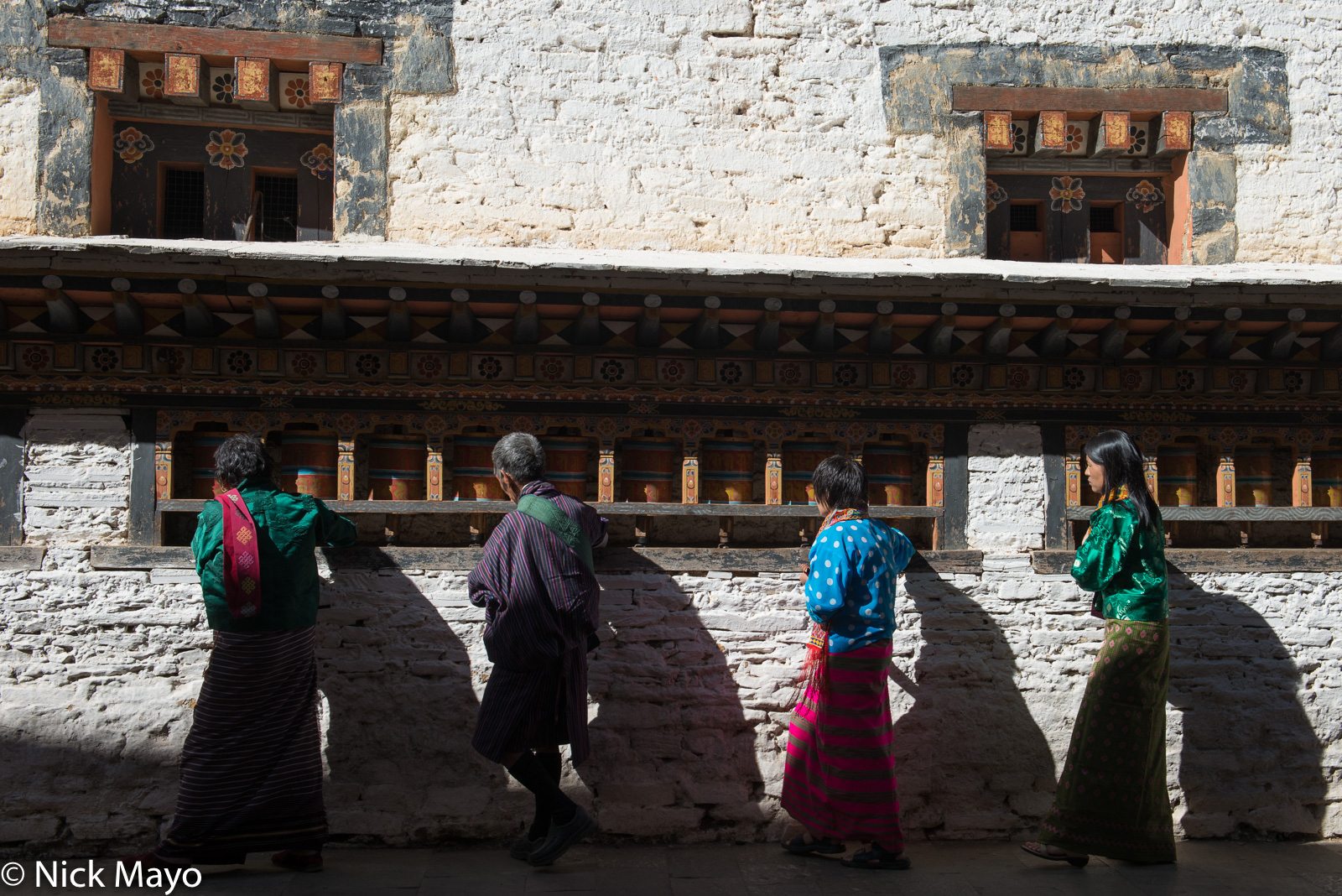 Buddhists turning the prayer wheels at Mongar dzong during the annual tshechu.