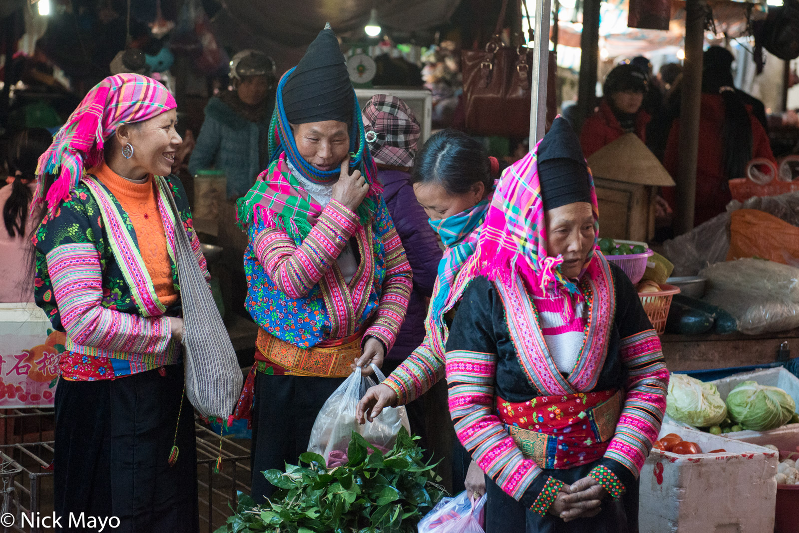 White Hmong (Miao) women selling vegetables at Sin Ho market.