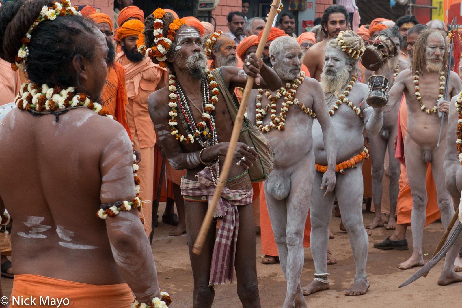 Naga sadhus at a halt in the Shivaratri festival procession at Rajim.