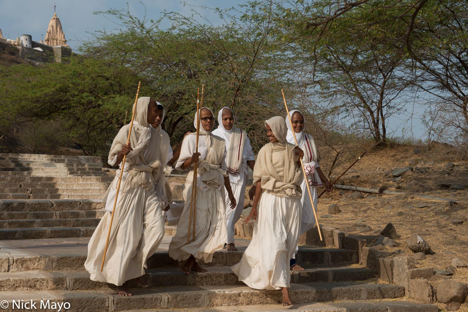 A group of Jain nuns descending from the Shatrunjaya Hill temple complex at Palitana.