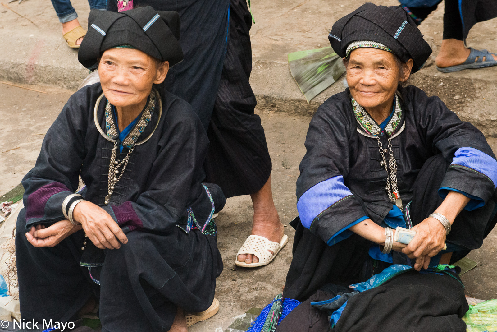 Two traditionally dressed Nung (Zhuang) women at Su Phi market.