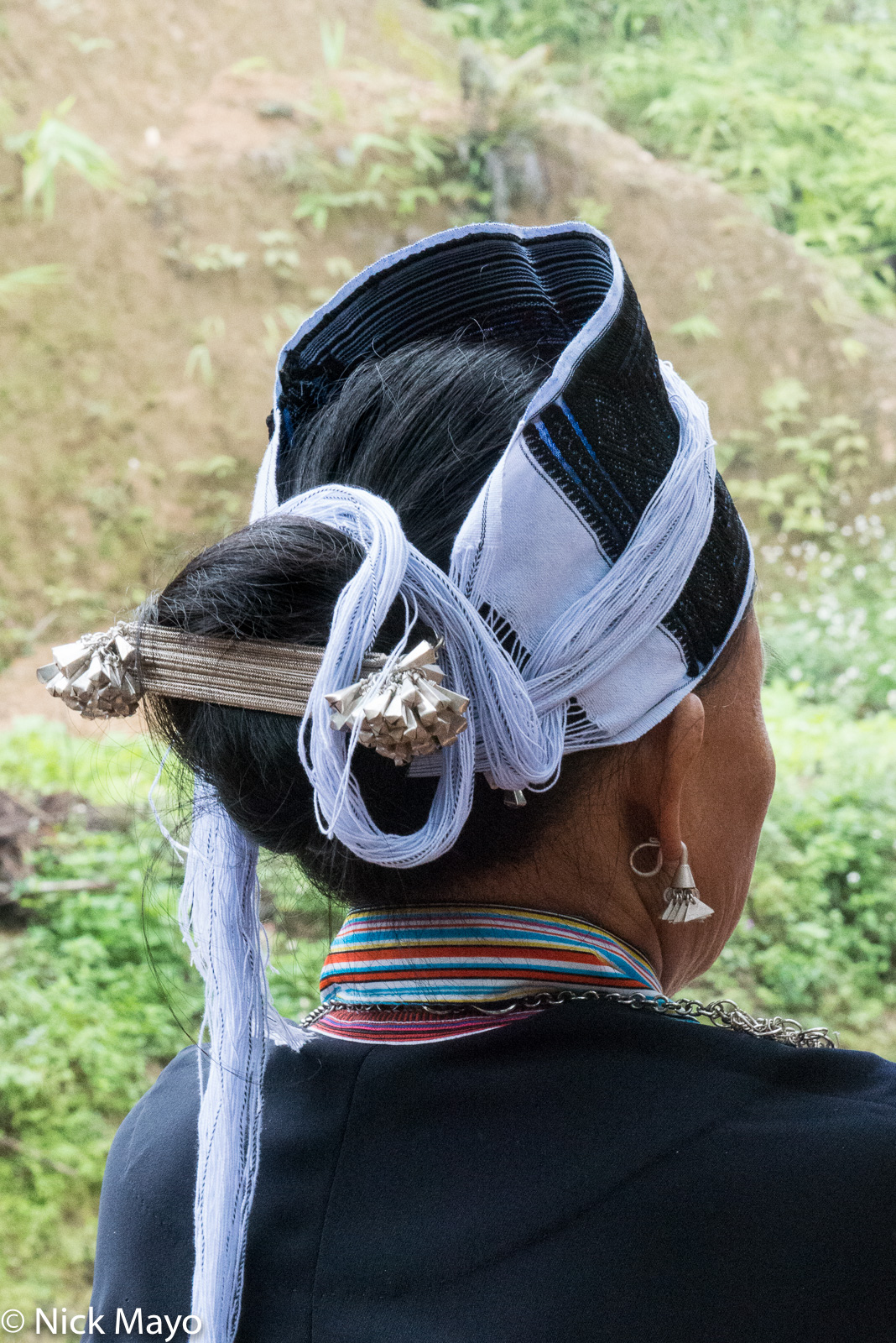 Hair piece and earring of a Dao Ao Dai woman at a wedding in Nam Dich.
