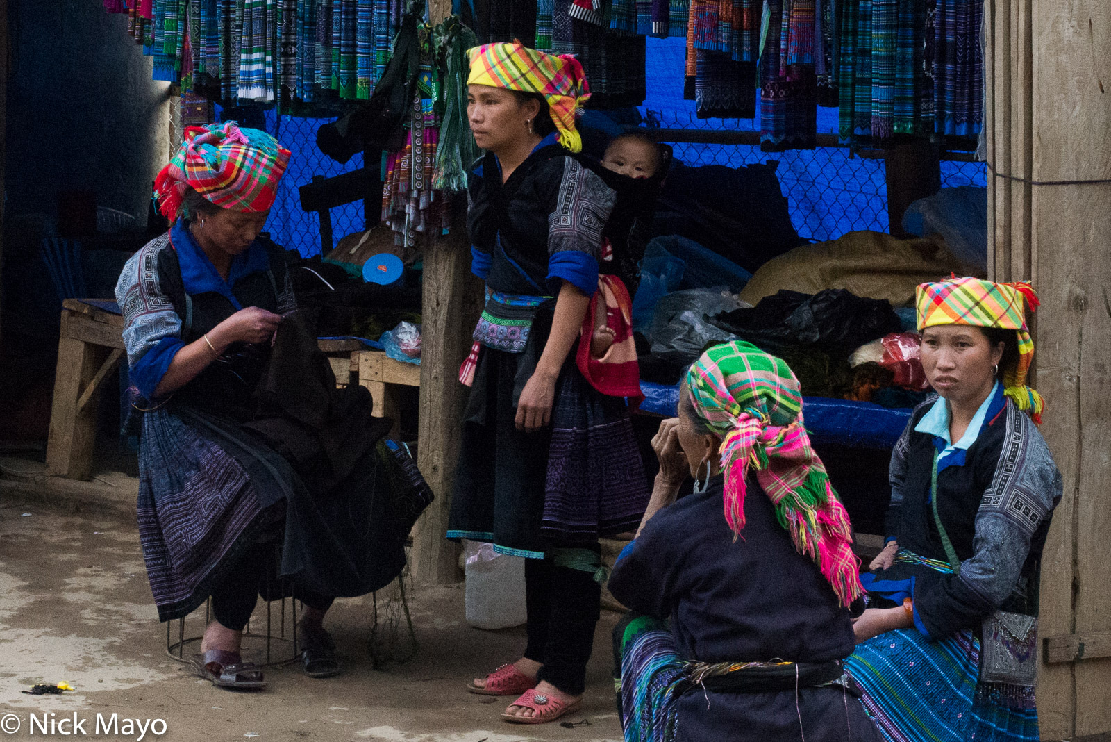 Blue Hmong women outside of a clothes shop in Mu Cang Chai.
