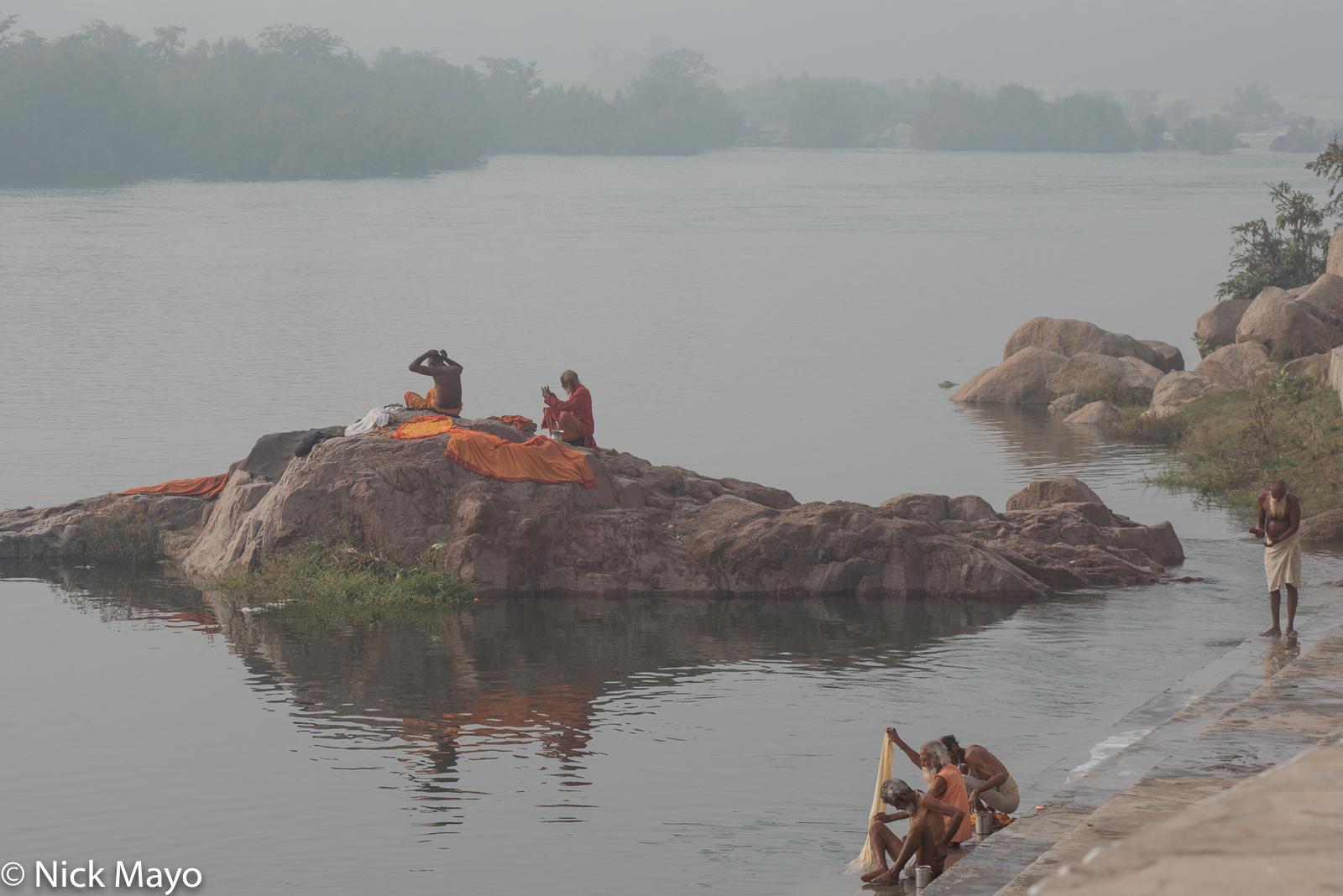 Sadhus bathing at the Kanchana ghat at Orchaa.