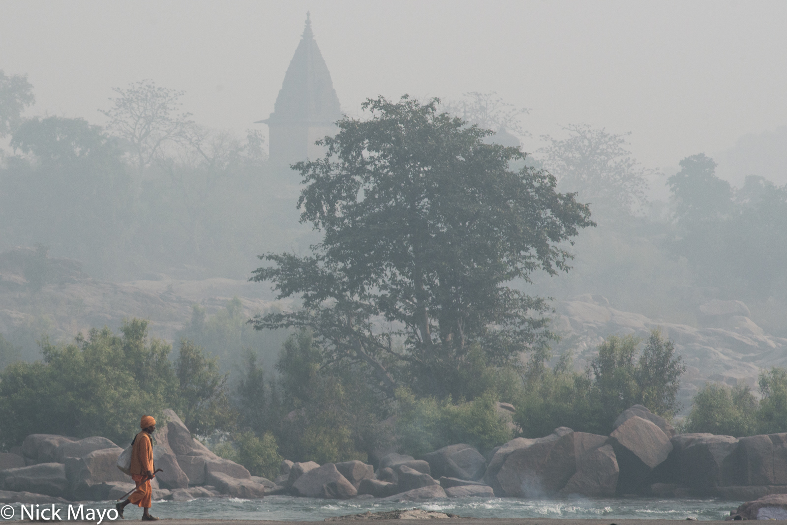 A wandering sadhu heading out of Orchaa town in the morning hours.