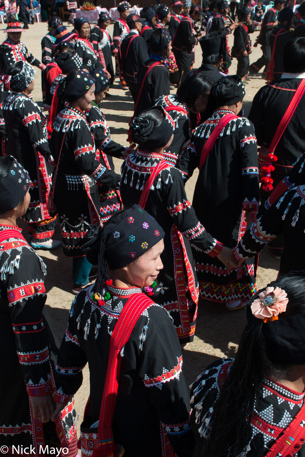 Lahu women dancing in a circle at their New Year festival in Kengtung.