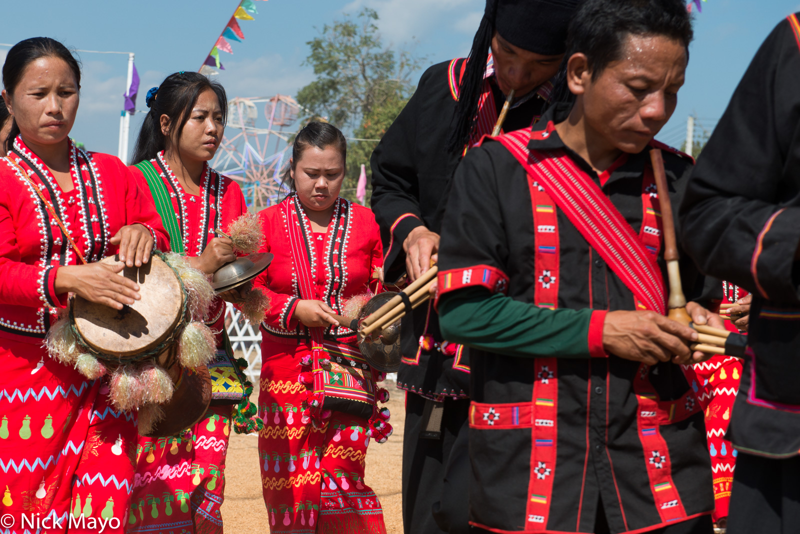 Lahu Na musicians, playing variously pipes, a drum and cymbals, at their New Year festival in Ba Bi.