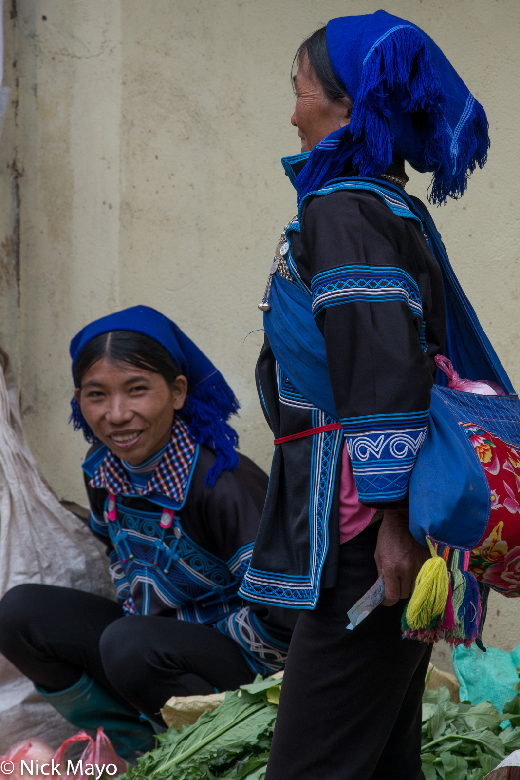 Two Hani women selling vegetables at the New Year market in Muong Hum.