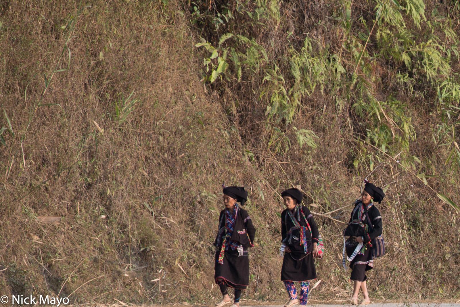 Three Lao women making a New Year visit at Nha Lung.