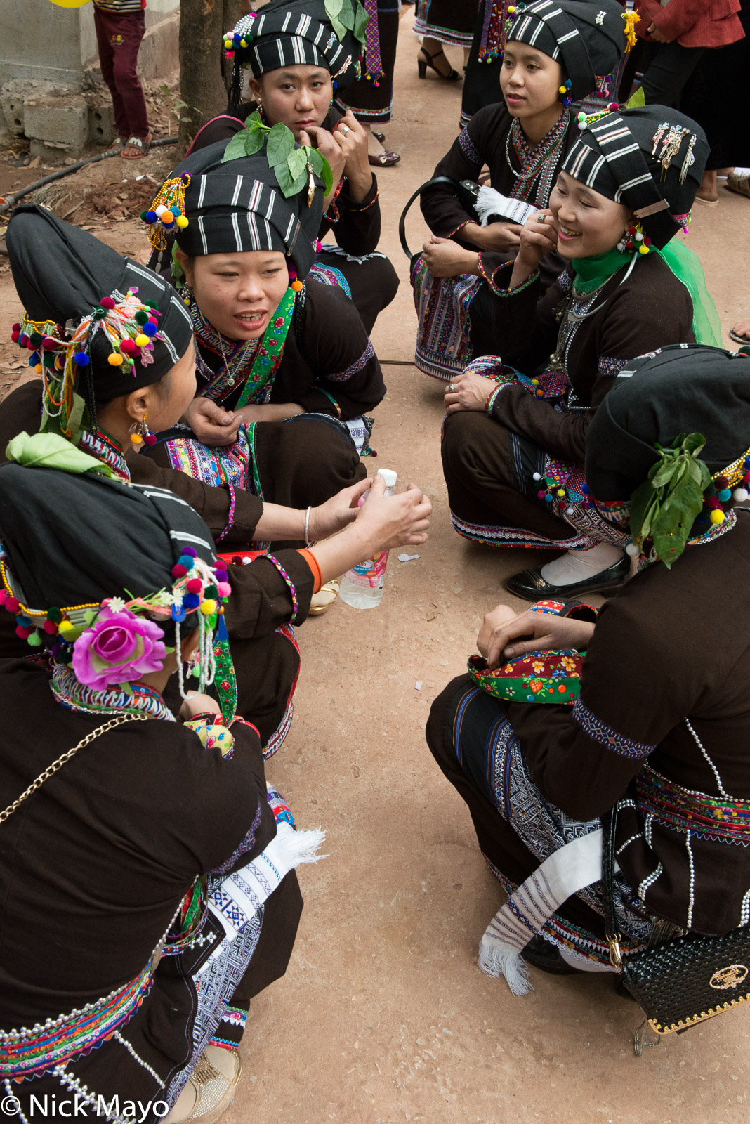 A group of Lu waiting for lunch at a New Year festival in the Nam Ma valley.