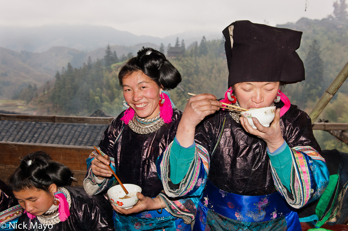 Women from Miao Gu village eating at a baby shower lunch.