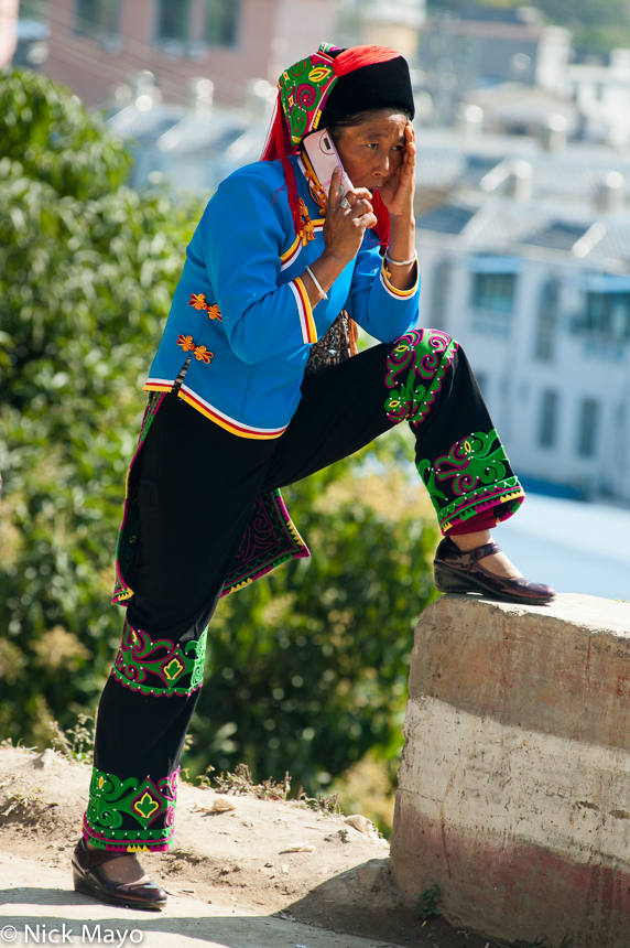 A Hani woman wearing a traditional hat and clothes in Da Hei Shan.