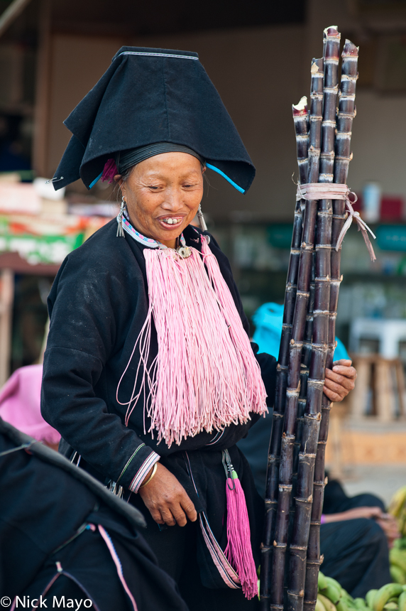 China,Earring,Hat,Market,Sugar Cane,Yao,Yunnan, photo